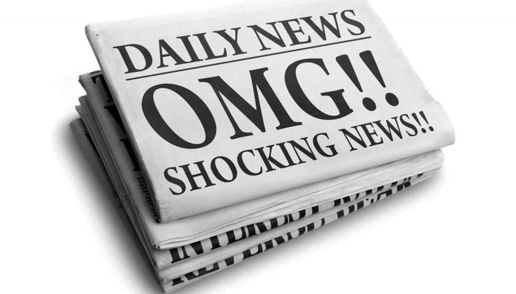 Daily news newspaper headline reading OMG shocking news concept