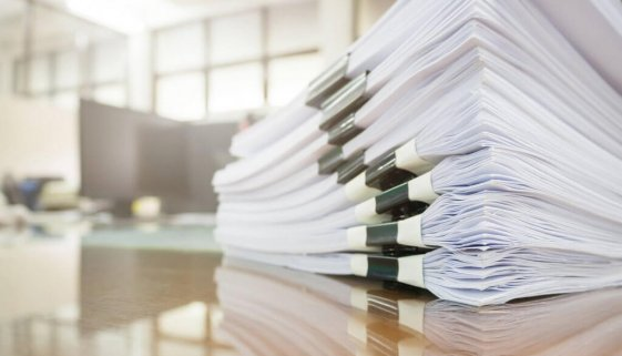 bigstock-Pile-Of-Unfinished-Documents-O-137040185